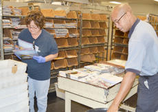 """<div class=""""source"""">Calen McKinney</div><div class=""""image-desc"""">Cherie Bleemel, at left, and Damarco Richardson sort through mail on Friday morning. Beginning in August, employees will only sort mail five days a week instead of six. The United States Postal Service announced last week that mail will no longer be delivered on Saturday.</div><div class=""""buy-pic""""><a href=""""/photo_select/42567"""">Buy this photo</a></div>"""