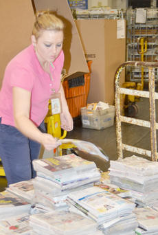 """<div class=""""source"""">Calen McKinney</div><div class=""""image-desc"""">Kristina Corbin sorts through mail on Friday morning. Beginning in August, employees will only sort mail five days a week instead of six. The United States Postal Service announced last week that mail will no longer be delivered on Saturday.</div><div class=""""buy-pic""""><a href=""""/photo_select/42570"""">Buy this photo</a></div>"""