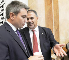 """<div class=""""source"""">LEGISLATIVE RESEARCH COMMISSION</div><div class=""""image-desc"""">House Republican Whip John Carney, R-Campbellsville, at right, confers with Rep. Ryan Quarles, R-Georgetown, before the start of a recent day's legislative session in the Kentucky House of Representatives.</div><div class=""""buy-pic""""></div>"""