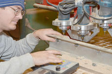 """<div class=""""source"""">Calen McKinney</div><div class=""""image-desc"""">Jordan Stapp places a block of wood on his equipment to begin the carving process. He and his father, Morgan Stapp, are making this year's official state ornament. After a machine carves a depiction of the old governor's mansion, the Stapps finish each by hand.</div><div class=""""buy-pic""""><a href=""""/photo_select/41672"""">Buy this photo</a></div>"""