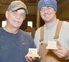 """<div class=""""source"""">Calen McKinney</div><div class=""""image-desc"""">Morgan Stapp, at left, and his son, Jordan, are making this year's official state ornament. K&M Crafts, named after Kathy and Morgan Stapp, has made the ornament for the past three years.</div><div class=""""buy-pic""""><a href=""""/photo_select/41673"""">Buy this photo</a></div>"""