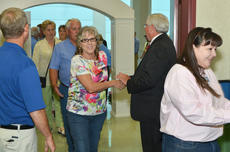 """<div class=""""source"""">Calen McKinney</div><div class=""""image-desc"""">Taylor County Judge/Executive Eddie Rogers, at right, and Magistrate John Gaines, at left, welcome the crowd to the reception.</div><div class=""""buy-pic""""><a href=""""/photo_select/46523"""">Buy this photo</a></div>"""