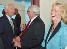 """<div class=""""source"""">Calen McKinney</div><div class=""""image-desc"""">Taylor County Judge/Executive Eddie Rogers and his wife, Theresia, share a laugh with Kentucky Gov. Steve Beshear.</div><div class=""""buy-pic""""><a href=""""/photo_select/46525"""">Buy this photo</a></div>"""