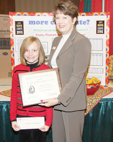 """<div class=""""source""""></div><div class=""""image-desc"""">Molly Sullivan, left, a fifth-grade student at Taylor County Elementary School, was presented with an award of recognition by Vickie Bryant, District 4 Chair of the Kentucky Farm Bureau Women's Committee, right, for her participation in the 2010 Science in Agriculture program. </div><div class=""""buy-pic""""></div>"""