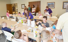 "<div class=""source"">Calen McKinney</div><div class=""image-desc"">Taylor County Public Library is offering a summer feeding program for the first time this year. And, so far, Youth Librarian Emily Snyder says staff members are pleased with the turnout. About 15 children ate free lunch last Wednesday.</div><div class=""buy-pic""><a href=""/photo_select/45118"">Buy this photo</a></div>"
