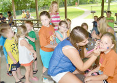 """<div class=""""source"""">Calen McKinney</div><div class=""""image-desc"""">A long line of children wait to have their faces' painted.</div><div class=""""buy-pic""""><a href=""""/photo_select/45266"""">Buy this photo</a></div>"""