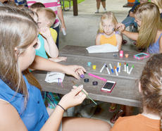 """<div class=""""source"""">Calen McKinney</div><div class=""""image-desc"""">A long line of children wait to have their faces' painted.</div><div class=""""buy-pic""""><a href=""""/photo_select/45268"""">Buy this photo</a></div>"""