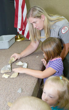 """<div class=""""source"""">Calen McKinney</div><div class=""""image-desc"""">Grinnell shows children fossils that were found in the GRL area.</div><div class=""""buy-pic""""><a href=""""/photo_select/45257"""">Buy this photo</a></div>"""