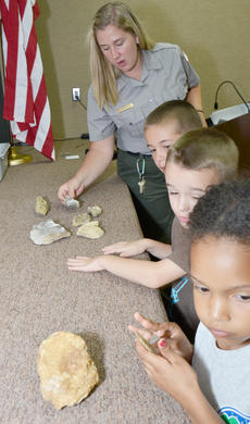 """<div class=""""source"""">Calen McKinney</div><div class=""""image-desc"""">Grinnell shows children fossils that were found in the GRL area.</div><div class=""""buy-pic""""><a href=""""/photo_select/45259"""">Buy this photo</a></div>"""