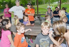 """<div class=""""source"""">Calen McKinney</div><div class=""""image-desc"""">A long line of children wait to have their faces' painted.</div><div class=""""buy-pic""""><a href=""""/photo_select/45264"""">Buy this photo</a></div>"""