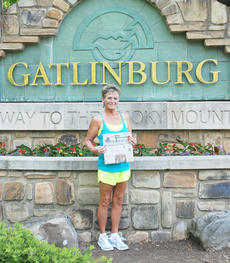 "<div class=""source""></div><div class=""image-desc"">Helen Swallows of Taylor County recently traveled to Gatlinburg, Tenn., and took along a copy of the Central Kentucky News-Journal. </div><div class=""buy-pic""></div>"