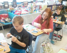 """<div class=""""source""""></div><div class=""""image-desc"""">Taylor County Extension Agent for 4-H and Youth Development Amanda Sublett recently made poinsettias with Taylor County students. </div><div class=""""buy-pic""""></div>"""
