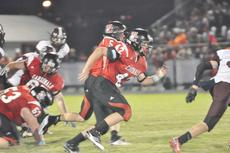 """<div class=""""source"""">Bobby Brockman</div><div class=""""image-desc"""">Dylan Bright (42) leads the way for Daulton Turpin during Taylor County's 40-0 win over Breckinridge County on Sept. 14.</div><div class=""""buy-pic""""><a href=""""http://web2.lcni5.com/cgi-bin/c2newbuyphoto.cgi?pub=085&orig=TC11.jpg"""" target=""""_new"""">Buy this photo</a></div>"""