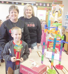 "<div class=""source""></div><div class=""image-desc"">Dawson Propes, in front, is pictured with TCES Principal Donna Williams and Melissa Long, vice principal.</div><div class=""buy-pic""></div>"