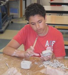 "<div class=""source""></div><div class=""image-desc"">Noah Eubank works with clay.</div><div class=""buy-pic""></div>"