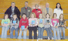 "<div class=""source""></div><div class=""image-desc"">The Campbellsville Rotary Club presented every third-grade student at Taylor County Elementary School with a new dictionary on Wednesday, Dec. 1. Pictured are a few of the students who received the dictionaries. From left, front: Bethany Harris, Seth Anderson, Austin Harris, Akeelah Duncan, Julie Stone, Autumn Wooley, Mercury Cox and Mariah Satterly. Back: Taylor County Superintendent Roger Cook, Rotary members Allen Gaddis, Jane Wheatley and Joe Walters and teacher Tonya Rogers.</div><div class=""buy-pic""></div>"