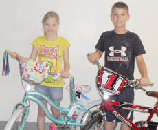 """<div class=""""source""""></div><div class=""""image-desc"""">Taylor County Elementary School third-grade students Carly Johnson and Camden Anderson recently won bicycles after their names were selected in a drawing.</div><div class=""""buy-pic""""></div>"""