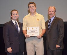 """<div class=""""source""""></div><div class=""""image-desc"""">Lonnie Lawson, right, president and CEO of The Center for Rural Development, and Delaney Stephens, left, community liaison and youth programs coordinator, present 2013 Rogers Scholars graduate and Taylor County High School student Grant Cox with a certificate of achievement acknowledging his successful completion of the program.</div><div class=""""buy-pic""""></div>"""