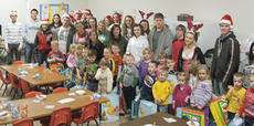 """<div class=""""source""""></div><div class=""""image-desc"""">Taylor County High School Cardinal Kroger staff recently shopped for the Head Start students' Christmas party. DECA members went to the Head Start classrooms and delivered 37 presents to the children. </div><div class=""""buy-pic""""></div>"""