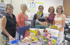 "<div class=""source""></div><div class=""image-desc"">Campbellsville Independent School District family resource director Sue Crabtee, center, accepts school supplies from Patty Evans, Karen Vaughn, Mitzi Tedder and Diane Rogers.</div><div class=""buy-pic""></div>"