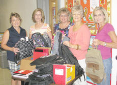 "<div class=""source""></div><div class=""image-desc"">Patty Evans, Diane Rogers, Karen Vaughn and Mitzi Tedder deliver school supplies to Taylor County School District family resource director Ann Mattingly, center. </div><div class=""buy-pic""></div>"