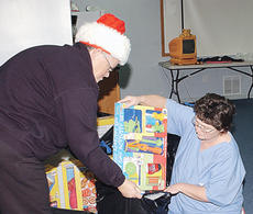 """<div class=""""source"""">James Roberts</div><div class=""""image-desc"""">Campbellsville/Taylor County Rescue EMT Judy Walden, left, and volunteer Teresa Turner bag gifts for Rescue's Toys for Tots program.</div><div class=""""buy-pic""""><a href=""""/photo_select/20013"""">Buy this photo</a></div>"""