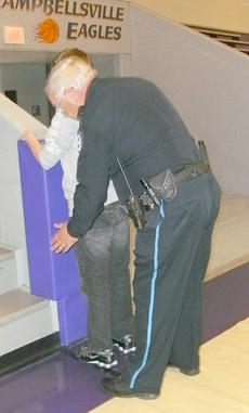 "<div class=""source""></div><div class=""image-desc"">School Resource Officer Roger Stiles shows an example of a pat-down procedure on a student. </div><div class=""buy-pic""></div>"