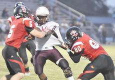 """<div class=""""source"""">Bobby Brockman</div><div class=""""image-desc"""">Taylor County defenders Daulton Turpin (5) and Brandon Williams (80) wrap up Marion County's Enrico Floyd (8) during the Cardinals' 21-15 home-field loss to the Knights on Friday.</div><div class=""""buy-pic""""><a href=""""/photo_select/40483"""">Buy this photo</a></div>"""