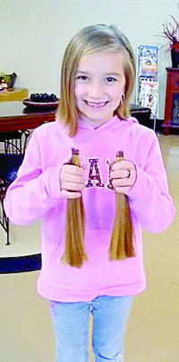 "<div class=""source""></div><div class=""image-desc"">Kacie Renae Underwood, 7, recently donated two 10-inch ponytails to Locks of Love. </div><div class=""buy-pic""><a href=""/photo_select/9242"">Buy this photo</a></div>"