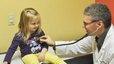 """<div class=""""source"""">Leslie Moore</div><div class=""""image-desc"""">Dr. Steve Baum of U of L Pediatrics-Campbellsville gives Haylie Stone, 3, a routine check-up. Baum said it is important for parents of young children like Haylie to follow the recommended vaccination schedule for optimal protection against infectious diseases.</div><div class=""""buy-pic""""><a href=""""http://web2.lcni5.com/cgi-bin/c2newbuyphoto.cgi?pub=085&orig=Vaccination%2BStory%2BPhoto.jpg"""" target=""""_new"""">Buy this photo</a></div>"""