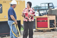 "<div class=""source"">Leslie Moore</div><div class=""image-desc"">Campbellsville Water and Sewer Co. comptroller Cheryl Sullivan talks with project foreman Dwayne Cox about the progress of the city's 1-million-gallon water storage tank.</div><div class=""buy-pic""><a href=""/photo_select/46156"">Buy this photo</a></div>"