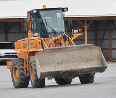 """<div class=""""source"""">Leslie Moore</div><div class=""""image-desc"""">Taylor County Road Department employee Todd McCubbin drives a front-end loader, one of the vehicles used to clear roadways of ice and snow.</div><div class=""""buy-pic""""><a href=""""http://web2.lcni5.com/cgi-bin/c2newbuyphoto.cgi?pub=085&orig=Winter%2BDriving%2B1.jpg"""" target=""""_new"""">Buy this photo</a></div>"""