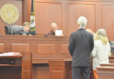 """<div class=""""source"""">Calen McKinney</div><div class=""""image-desc"""">Kathleen Wise stands with her attorney, William Butler of Louisville, as Taylor Circuit Court Judge Dan Kelly sentences her to life in prison for killing her husband, Joseph Kenneth Wise, with a liquid morphine overdose. Taylor Circuit Court Clerk Rodney Burress is seated next to Kelly.</div><div class=""""buy-pic""""><a href=""""/photo_select/40103"""">Buy this photo</a></div>"""