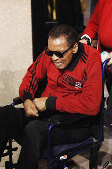 "<div class=""source"">Jeff Moreland</div><div class=""image-desc"">In this 2014, Muhammad Ali  arrives for a college football game between the University of Louisville and Florida State University at Papa John's Cardinal Stadium in Louisville.</div><div class=""buy-pic""></div>"