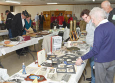 """<div class=""""source"""">Calen McKinney</div><div class=""""image-desc"""">Residents look at artifacts on display at the American Legion.</div><div class=""""buy-pic""""><a href=""""/photo_select/48327"""">Buy this photo</a></div>"""