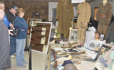 """<div class=""""source"""">Calen McKinney</div><div class=""""image-desc"""">Residents look at artifacts on display at the American Legion.</div><div class=""""buy-pic""""><a href=""""/photo_select/48328"""">Buy this photo</a></div>"""