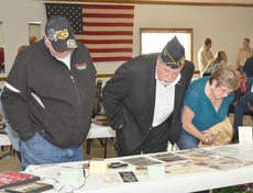 """<div class=""""source"""">Calen McKinney</div><div class=""""image-desc"""">Residents look at artifacts on display at the American Legion.</div><div class=""""buy-pic""""><a href=""""/photo_select/48329"""">Buy this photo</a></div>"""