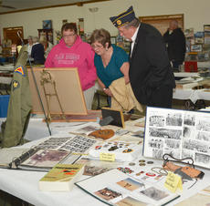 """<div class=""""source"""">Calen McKinney</div><div class=""""image-desc"""">Residents look at artifacts on display at the American Legion.</div><div class=""""buy-pic""""><a href=""""/photo_select/48330"""">Buy this photo</a></div>"""