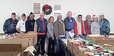 """<div class=""""source""""></div><div class=""""image-desc"""">The men and women at American Legion Post 82 gathered on Christmas Eve morning to deliver Christmas baskets.</div><div class=""""buy-pic""""></div>"""