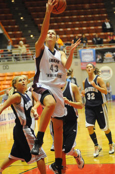 """<div class=""""source"""">Richard RoBards, Correspondent</div><div class=""""image-desc"""">Whitney Ballinger scored 27 points and pulled down 7 rebounds in a losing cause</div><div class=""""buy-pic""""><a href=""""/photo_select/9298"""">Buy this photo</a></div>"""