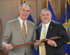 "<div class=""source"">Zac Oakes</div><div class=""image-desc"">Kentucky Chamber President and CEO Dave Adkisson, left, presents John ""Bam"" Carney a baseball bat for being chosen as the Kentucky Chamber of Commerce MVP. </div><div class=""buy-pic""><a href=""/photo_select/66186"">Buy this photo</a></div>"
