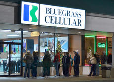 """<div class=""""source"""">Calen McKinney</div><div class=""""image-desc"""">Shoppers wait in line for Bluegrass Cellular to open at 6 a.m. on Friday.</div><div class=""""buy-pic""""><a href=""""/photo_select/48709"""">Buy this photo</a></div>"""