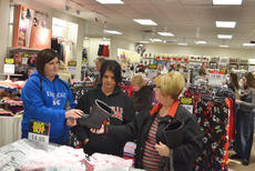 """<div class=""""source"""">Calen McKinney</div><div class=""""image-desc"""">Shoppers look for shoes, jewelry, clothing and bedding items at JCPenney on Thanksgiving night. The store opened at 8 p.m.</div><div class=""""buy-pic""""><a href=""""/photo_select/48712"""">Buy this photo</a></div>"""