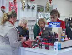 """<div class=""""source"""">Calen McKinney</div><div class=""""image-desc"""">Shoppers take advantage of sales at Merle Norman Cosmetic Studios early Friday morning.</div><div class=""""buy-pic""""><a href=""""/photo_select/48718"""">Buy this photo</a></div>"""