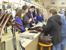 """<div class=""""source"""">Calen McKinney</div><div class=""""image-desc"""">Shoppers take advantage of a 50 percent off sale at Mitchell's between 8 and 9 a.m. on Friday.</div><div class=""""buy-pic""""><a href=""""/photo_select/48719"""">Buy this photo</a></div>"""