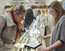 """<div class=""""source"""">Calen McKinney</div><div class=""""image-desc"""">Shoppers look at the selection at Tucker Diamonds and Gold on Friday morning. The store had a 50 percent off sale from 9 to 10 a.m.</div><div class=""""buy-pic""""><a href=""""/photo_select/48721"""">Buy this photo</a></div>"""
