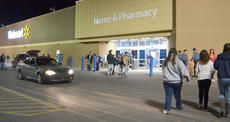 """<div class=""""source"""">Calen McKinney</div><div class=""""image-desc"""">Residents flocked to Walmart on Thanksgiving night to start their holiday shopping. Customers filled the parking lot and the lots of many nearby businesses. Photos weren't allowed inside Walmart during its Black Friday sales.</div><div class=""""buy-pic""""><a href=""""/photo_select/48723"""">Buy this photo</a></div>"""