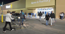 """<div class=""""source"""">Calen McKinney</div><div class=""""image-desc"""">Residents flocked to Walmart on Thanksgiving night to start their holiday shopping. Customers filled the parking lot and the lots of many nearby businesses. Photos weren't allowed inside Walmart during its Black Friday sales.</div><div class=""""buy-pic""""><a href=""""/photo_select/48724"""">Buy this photo</a></div>"""
