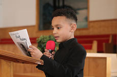 """<div class=""""source"""">Dennis George</div><div class=""""image-desc"""">Maddox Hawkins, 9, tells the story of Carter Woodson, the Father of Black History.</div><div class=""""buy-pic""""><a href=""""/photo_select/66624"""">Buy this photo</a></div>"""