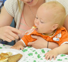 """<div class=""""source"""">Calen McKinney</div><div class=""""image-desc"""">Delaina Russell helps her son, Mason, 11 months, eat a bite of his pancake.</div><div class=""""buy-pic""""><a href=""""/photo_select/51219"""">Buy this photo</a></div>"""